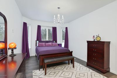Purple Bedroom with private bathroom and shower