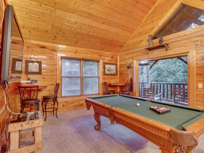 Photo for Spacious cabin w/ a private hot tub, game room, & mountain views!