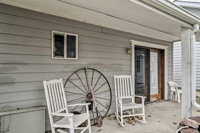 Relax on the back patio and gaze out at the 1 acre property.