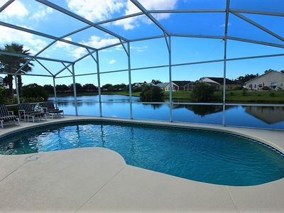 Photo for 4 Bedroom Kissimmee Vacation Rental with HUGE Salt Water Pool, Stunning Lake view, near Disney!