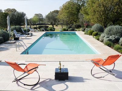 Photo for Old trulli, child friendly, special offers, modern, WIFI, private gated pool