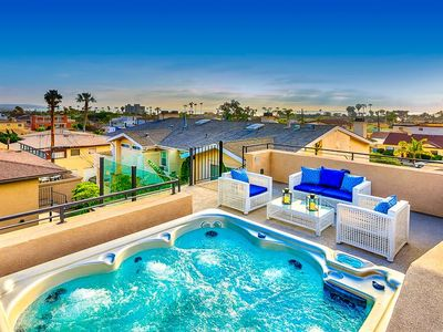 Photo for 25% OFF APR - Spacious Home w/ Firepit & Rooftop Spa, Close to Surf Spots!