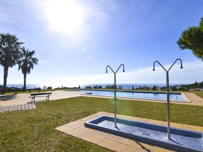Photo for Club Villamar - Nice and cozy semidetached holiday villa with access to a shared pool and located...