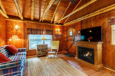 Living room and gas log heater/fireplace