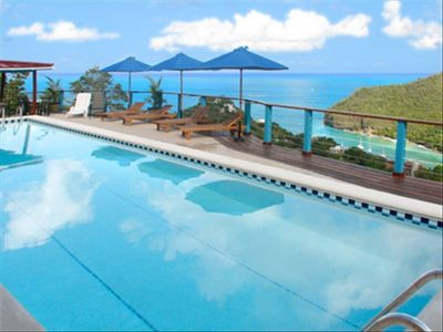 The swimming pool looks across Marigot Bay to the Caribbean sea