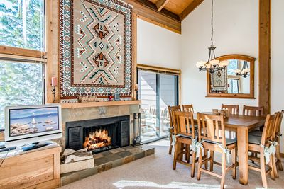 Dining Area - Enjoy a bite to eat next to the flickering fireplace.