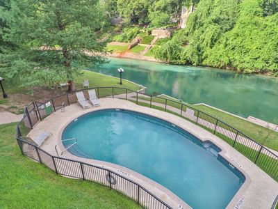 Photo for Comal Riverfront Condo w/ Pool, Large Deck & across from Schlitterbahn!