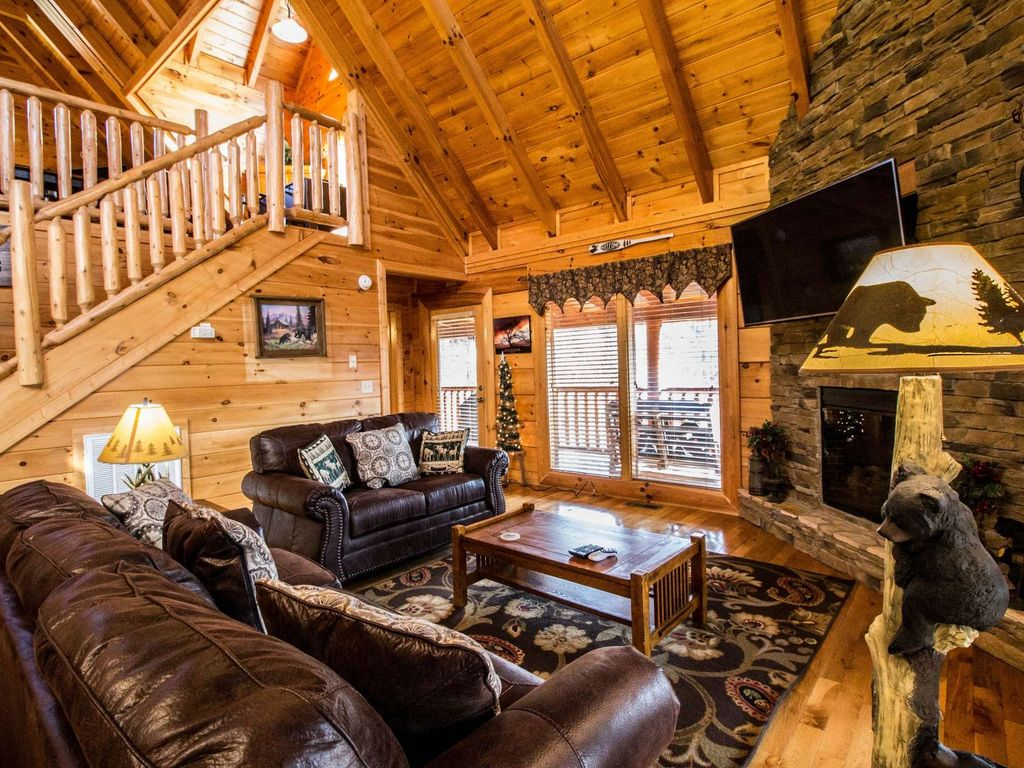 luxury cabin with wrap around porch scenic views game room tub