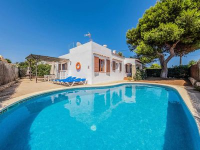 Photo for A pretty villa perfect for families, with a beautiful sandy beach, restaurants & shops in easy reach.