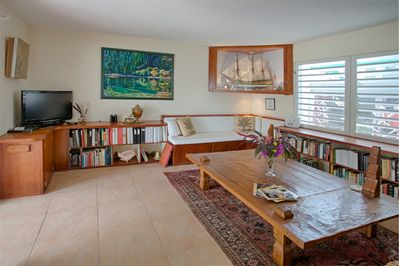 Living room with Smart TV, library,