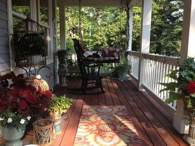 Welcoming front porch with swing is a perfect spot for morning coffee