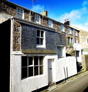 Photo for PILCHARD COTTAGE. Stylishly renovated cottage steps from St Ives harbour & beach