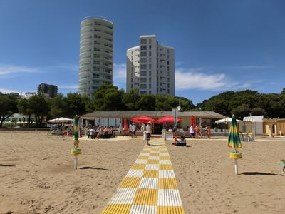 Photo for RESIDENCE TORRE ZANIER, beachfront, 8 seats with climate, washing machine and parking