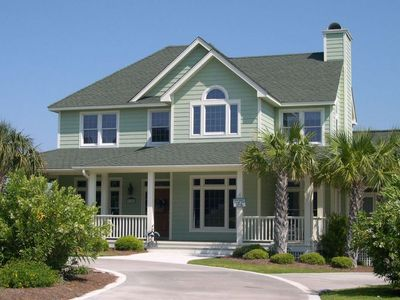 Photo for Home with Private Pool, Hot Tub, Golf Cart, 5 Bedrooms, seconds away from beach!
