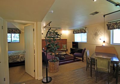 Enter bedroom w/ Q-size bed. Note large windows and  good light throughout.