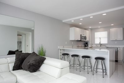 Quartz counter top with 6 swivel dining stools