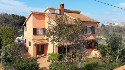 Photo for Villa Bastianich, with sea view. Three terraces, pool, garden with barbecue.