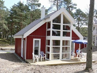 Photo for Luxury holiday house on the beach (about 50 m) with sea view, fireplace, sauna, whirlpool