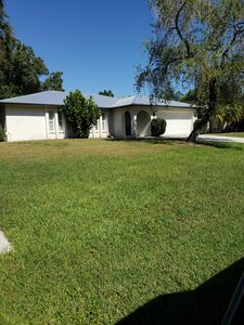 Photo for Comfortable updated 3 bedroom home with enclosed, heated pool and private yard.