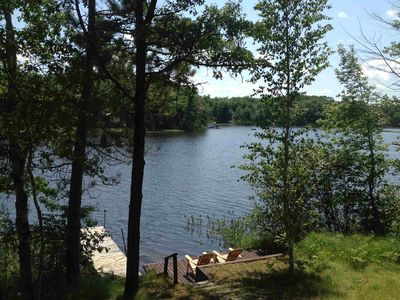 Photo for Very private lake setting with tall pines and beautiful sunsets.