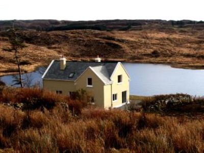 Photo for Beautiful lake side cottage in the heart of Connemara