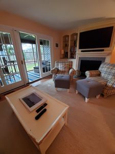 Photo for Come relax and enjoy this lovely townhouse.  Located just a mile away from downtown Rehoboth, outlet shopping,