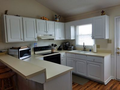 Newly Updated Kitchen with new cabinets, counter, stove and refrigerator