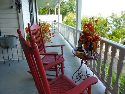 Front porch with 2 rockers, swing, table and 6 chairs