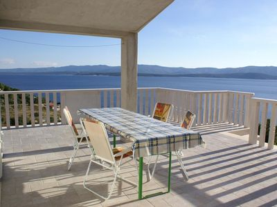 Photo for Two bedroom apartment with terrace and sea view Cove Vela Farska, Brač (A-2897-b)