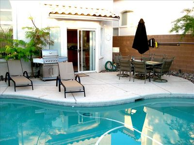 pool right outside the kitchen doors, easy access for cooking and beverages.....