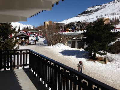 In front of ski slopes : start of skiing school and 4 seats chairlift