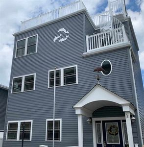 Photo for PET FRIENDLY, conveniently located one block from the beach and world famous boardwalk.
