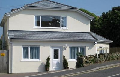 Photo for Peaceful Residential Location. Parking For 2 Cars. Sea Views. Walk To Beaches.