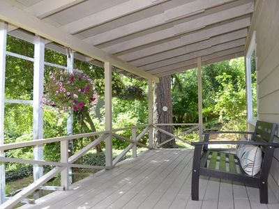 Photo for Sweet private cottage nestled in the woods minutes from downtown Coeur d'Alene