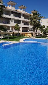 Photo for Stunning 2 bed 2 bath Appt with communal pool, gym and sauna, Golf 5 mins