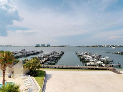 Photo for NEW LISTING! Waterfront condo w/ views, private balcony, & shared pool/hot tub