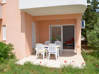 Photo for Comfortable ground floor apartment with terrace and bus stop next door