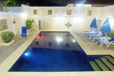 Majestic Villas 2,3 bedroom . Pool area at night time.