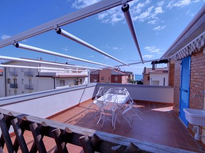 Photo for comfortable renovated apartment with terrace 100 meters from the sea