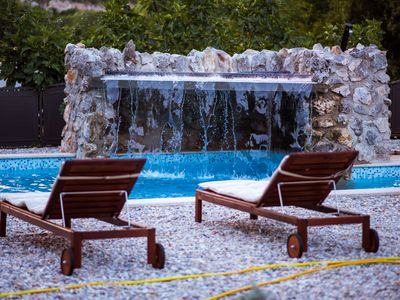 Photo for Romantic stone villa with pool, waterfall, large garden, 700 m from the sea