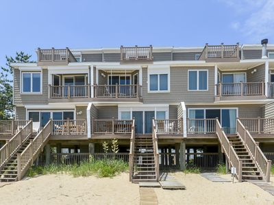 Photo for DIRECT OCEANFRONT- right on the beach!  FREE ACTIVITIES INCLUDED! Step off the deck onto the sand and enjoy some of the best views and breezes on the eastern shore.