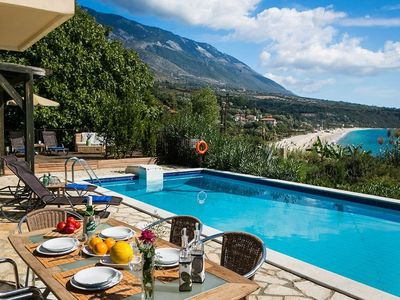 Photo for Luxury Beach Villa with Private Pool panoramic views of both Lourdas' glorious beach and the sparkli