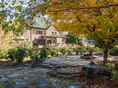 Photo for Spacious, dog-friendly riverfront lodge for fall, BBQ, hot tub