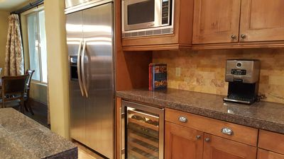 stainless steal appliances refrigerator and wine cellar