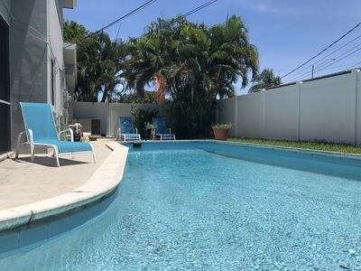 Photo for Private Poolside Oasis & Close to the Beach!