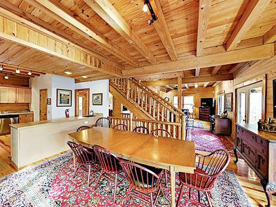 Dining Area - Serve up family feasts at the large wooden dining table.
