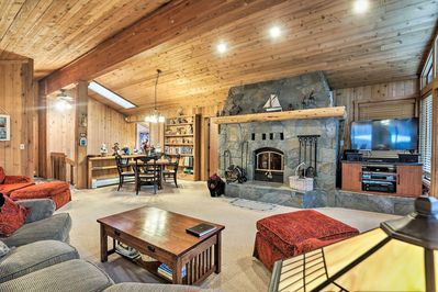 Upper level great room features comfortable family seating and wood burning fire