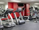 Fitness center with treadmills and cycling machines.