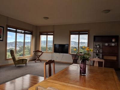 Photo for Elevated, sunny home - stunning views, central, w continental breakfast Hataitai