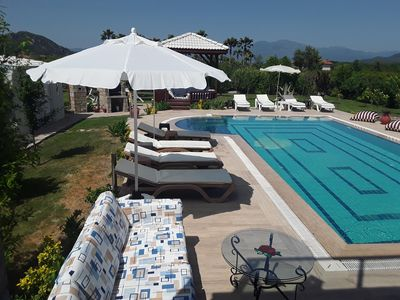 poolside seating and sunbeds